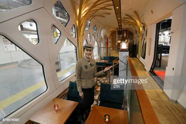 This picture taken on March 16 2017 shows a crew member gesturing in the lounge car of the Train Suite ShikiShima operated by East Japan Railway in...