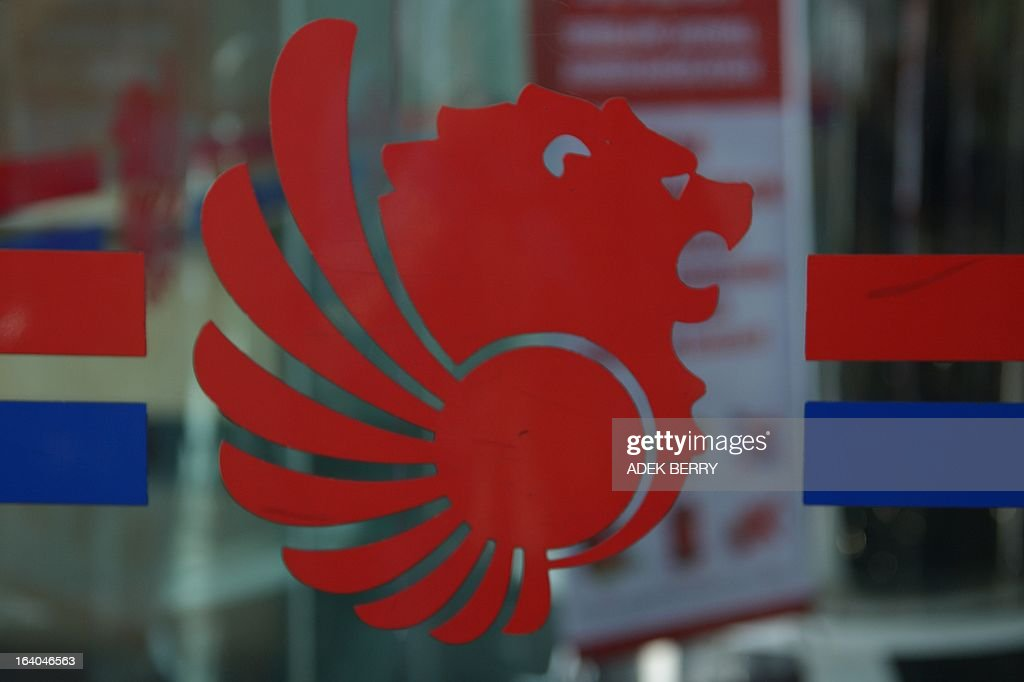 This picture taken on March 18, 2013 shows a logo for Lion Air, Indonesia's largest private carrier, displayed on a glass panel in Jakarta. European aircraft maker Airbus on March 18 announced a record order worth 18.4 billion euros (23.8 billion USD) from the Indonesian company Lion Air for 234 medium-range A320 jets.