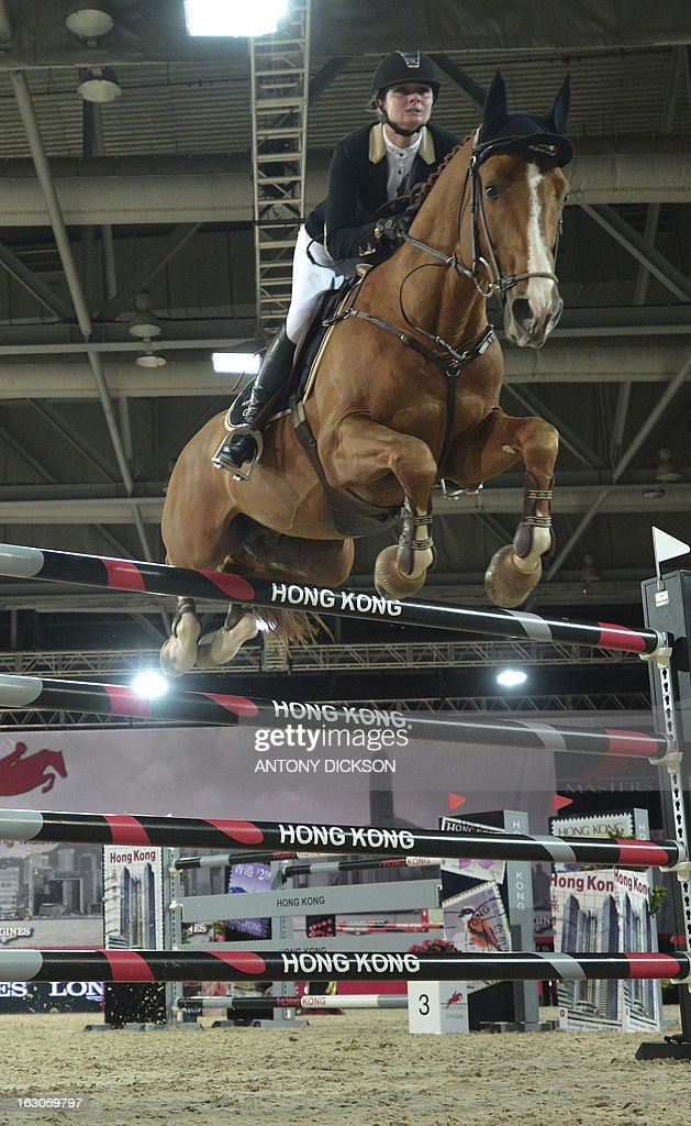 This picture taken on March 2, 2013 shows Anne Sophie Godart of France riding Carlitto Vant Zorgvliet as they compete in the international jumping competition Grand Prix equestrian event in Hong Kong. AFP PHOTO / Antony DICKSON