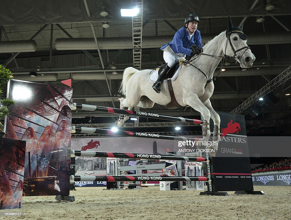 This picture taken on March 2, 2013 shows Gerco Schroder riding New Orleans as they compete in the international jumping competition Grand Prix equestrian event in Hong Kong. AFP PHOTO / Antony DICKSON