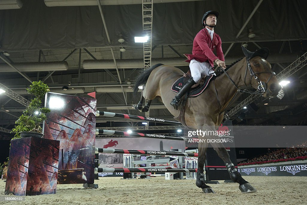 This picture taken on March 2, 2013 shows Pius Schwizer of Switzerland riding Verdi III as they compete in the international jumping competition Grand Prix equestrian event in Hong Kong. AFP PHOTO / Antony DICKSON