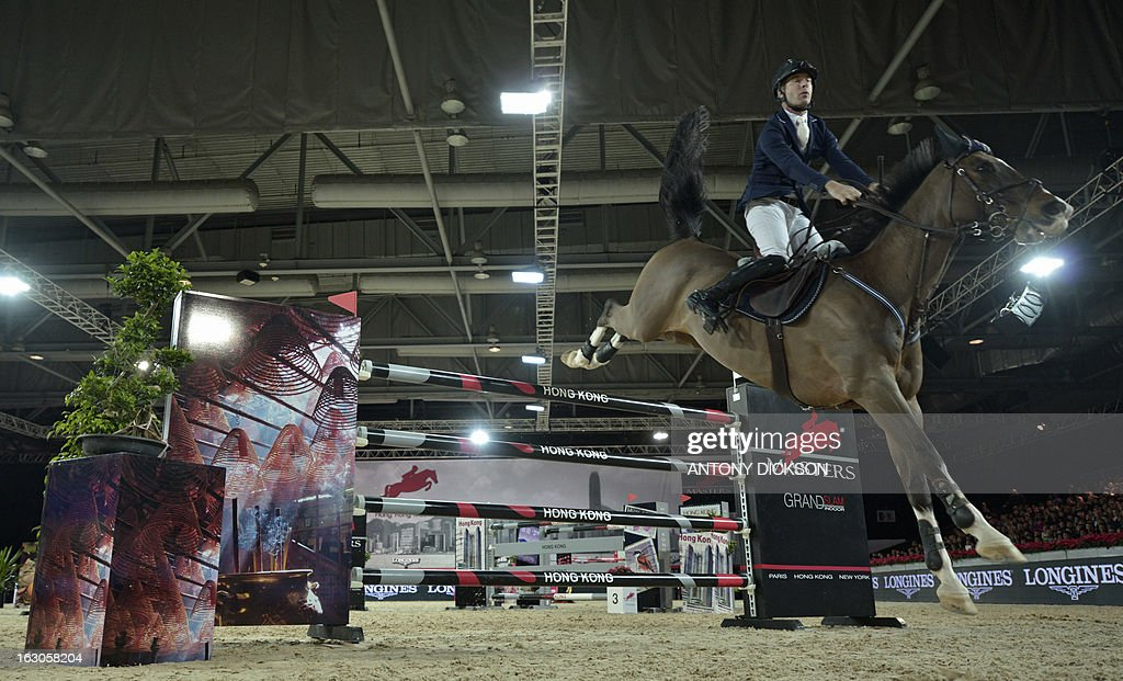 This picture taken on March 2, 2013 shows Richard Spooner of the US riding Cristallo as they compete in the international jumping competition Grand Prix equestrian event in Hong Kong. AFP PHOTO / Antony DICKSON