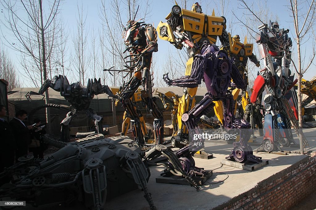 This picture taken on March 21 2014 shows a group of lifesized 'Transformer' models on display in a yard in Jinan east China's Shandong province A...