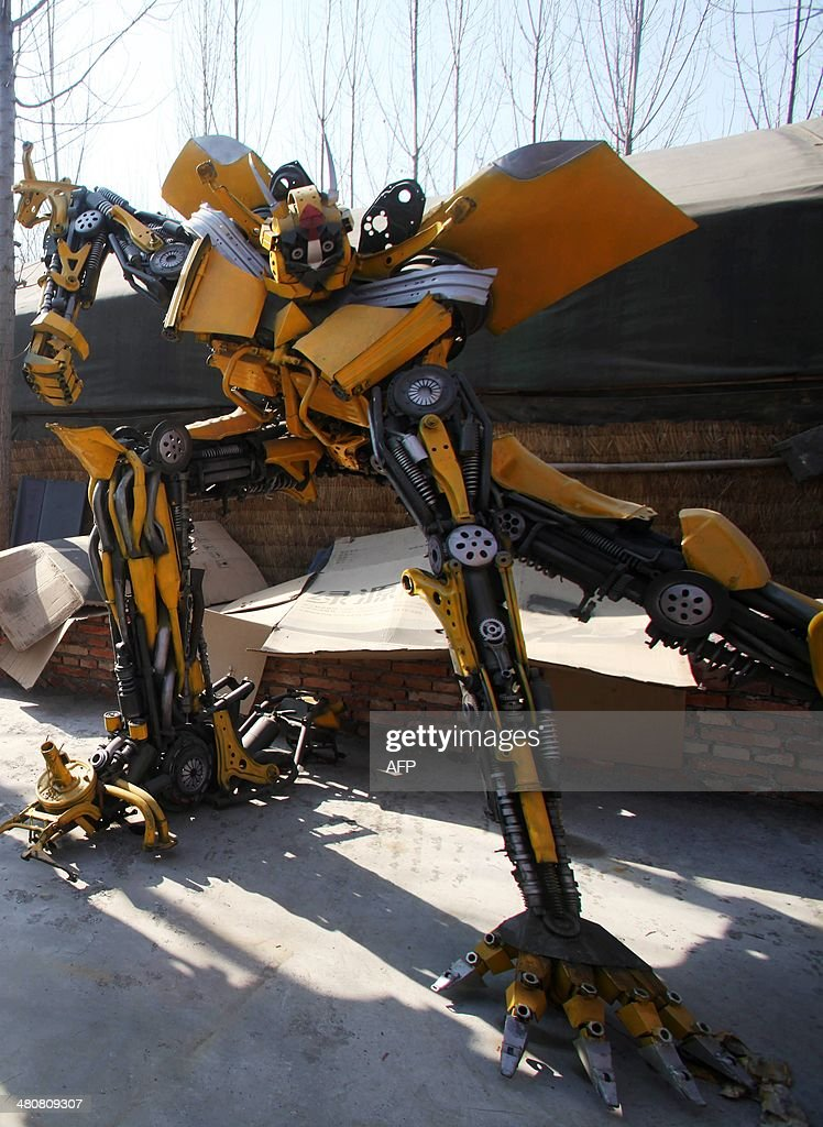 This picture taken on March 21 2014 shows a lifesized 'Transformer' model in a yard in Jinan east China's Shandong province A group of farmers in...