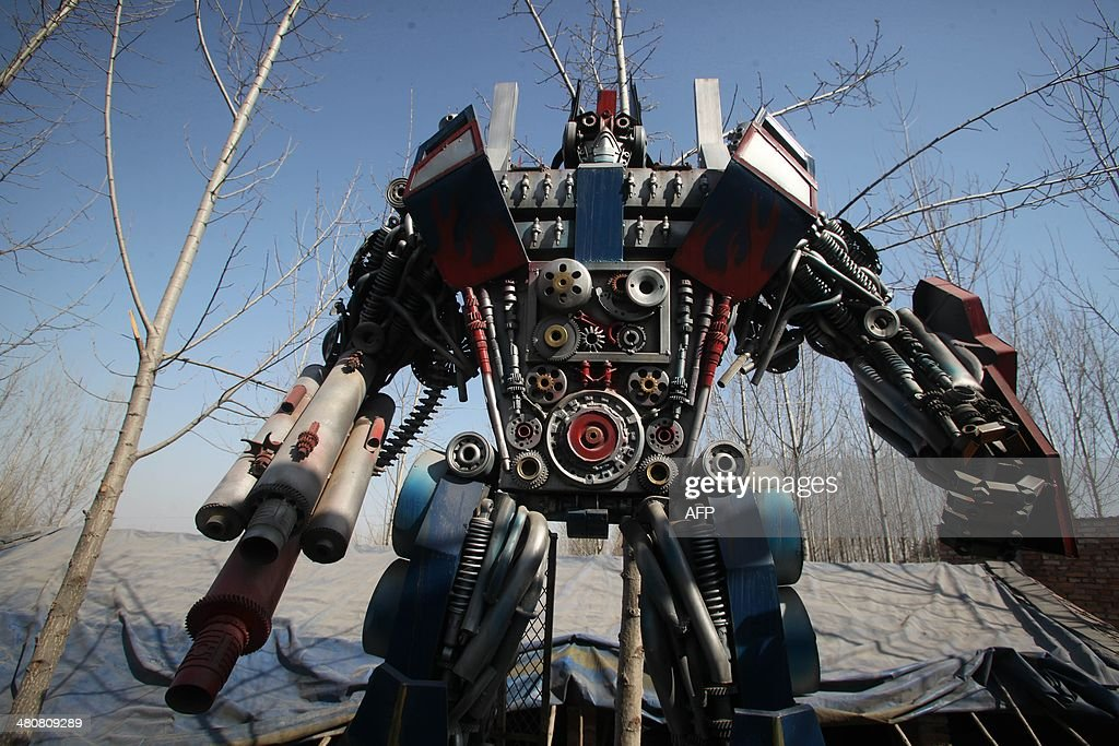 This picture taken on March 21 2014 shows a lifesized 'Transformer' model on display in a yard in Jinan east China's Shandong province A group of...