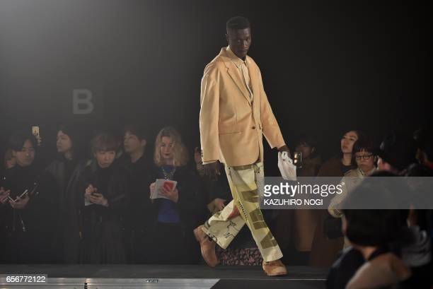This picture taken on March 21 2017 shows a model presenting a creation from Name by Japanese designer Noriyuki Shimizu during the 2017 Autumn/Winter...