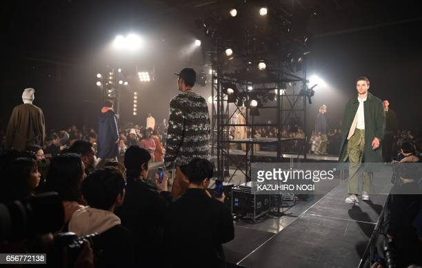 This picture taken on March 21 2017 shows models presenting a creation from Name by Japanese designer Noriyuki Shimizu during the 2017 Autumn/Winter...