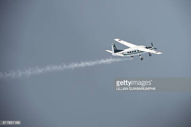 This picture taken on March 25 2016 shows a pair of Cessna 208 Caravan aircraft from the Thai Department of Royal Rainmaking depositing a sodium...