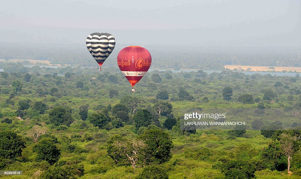 This picture taken on March 26 Hot air balloons participate in The Sri Lanka Balloon Festival over Yala National Park some 238 kilometers southeast...