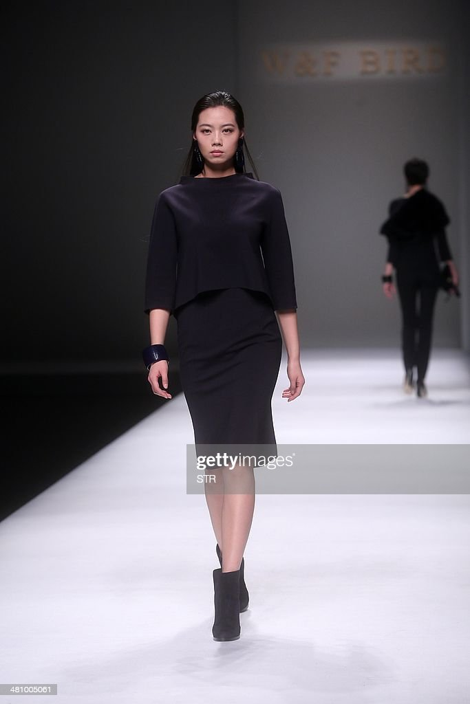 This picture taken on March 27, 2014 shows a model parading creations of 'W&F BIRD Collection' designed by Susanna Bracco and Marina Miglio during the bi-annual China Fashion Week in Beijing. The biannual China Fashion Week is being held in Beijing from March 25 to 31.
