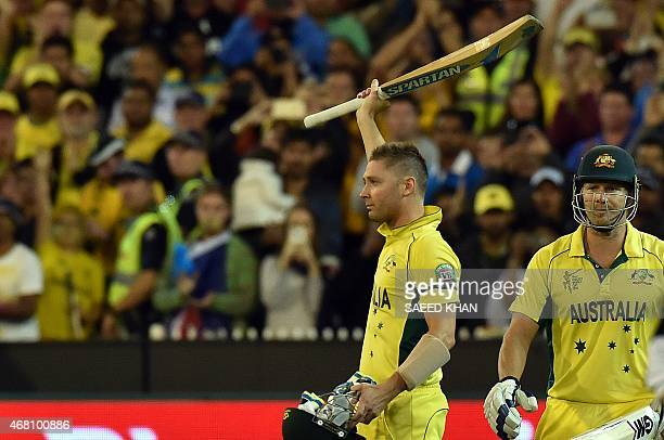 This picture taken on March 29 2015 shows Australia cricket team captain Michael Clarke acknowledging a standing ovation as he walks back to dressing...