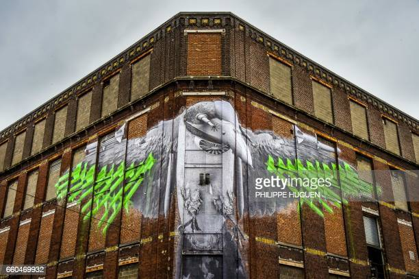 TOPSHOT This picture taken on March 29 2017 shows an artwork by French street artist Ludo as it is displayed at La Condition Publique in Roubaix La...