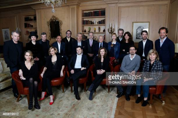 This picture taken on March 3 2015 shows the group of 'L'Express RTL' yearly palmares of the French bestselling authors for 2014 posing at the Hotel...