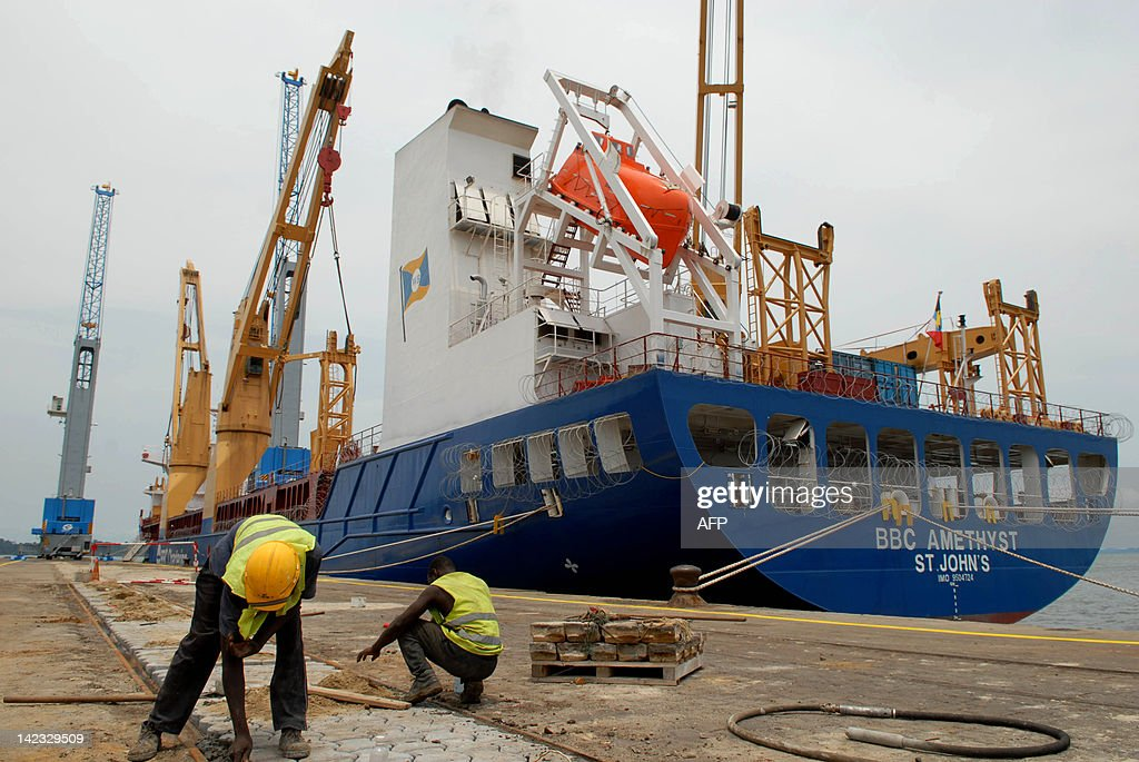 This picture taken on March 31 2012 shows the unloading of new cranes in Libreville's port AFP PHOT / XAVIER BOURGOIS