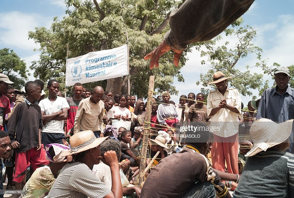 This picture taken on March 4 2015 shows people waiting for a distribution of bags of rice by World Food Program staff in the village of Berano in...