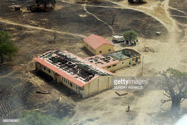 This picture taken on March 5 2015 shows an arial view of the burntout classrooms of a school in Chibokin Northeastern Nigeria from where Boko Haram...