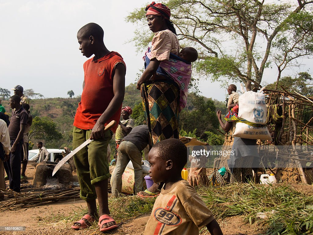 This picture taken on March 5, 2013, shows refugees at Rwamwanja refugee camp, in the Kamwenge district, western Uganda, home to over 35000 refugees, most of them from Democratic Republic of Congo. Four thousand people fled new clashes in eastern Democratic Republic of Congo on February 28, 2013 and crossed the border into neighbouring Uganda, the Red Cross said on March 1. '4,000 refugees crossed into Uganda through Bunagana border,' the Red Cross said.