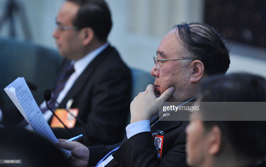 This picture taken on March 6, 2013 shows Chongqing mayor Huang Qifan (C) during a panel discussion of the Chongqing delegation as part of the National People's Congress (NPC) events in Beijing. Sun stressed that Chongqing is now staying 'low-profile and pragmatic', maintaining its political and social stability as well as economic growth and said that the Bo Xilai case is under judiciary procedures. CHINA