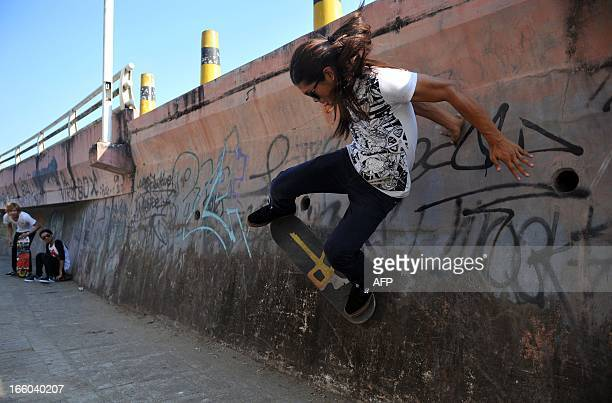 This picture taken on March 9 2013 shows a skater riding on a concrete wall supporting a flyover at Nanat Taw Bridge in Yangon With their indie...