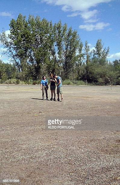 This picture taken on March 9 2015 in the Argentine province of La Rioja shows the three French sports stars Champion sailor Florence Arthaud Olympic...