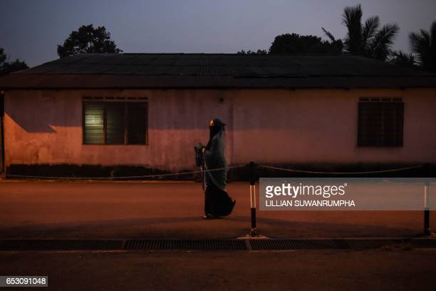 TOPSHOT This picture taken on March 9 2017 shows a Malaysian woman walking to evening prayers at an Islamic center in Kuala Lumpur / AFP PHOTO /...