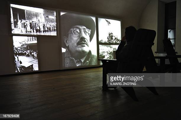 This picture taken on May 1 2013 shows a visitor at the Mark Rothko museum in Daugavpils Latvia A museum dedicated to painter Mark Rothko opened in...