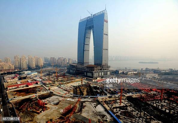 This picture taken on May 1 2014 shows the 3018meter archshaped building which will house 69 stores a luxury hotel offices and shopping mall in...