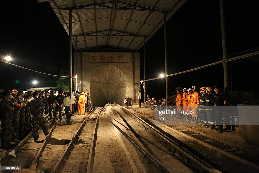 This picture taken on May 11, 2013 shows rescuers gathering at the entrance of Taozigou mine in Luzhou city, Sichuan Province. An accidental explosion at a coal mine in southwest China killed 27 miners on May 11, state media said, in the second deadly incident to hit the country's troubled industry in as many days. CHINA