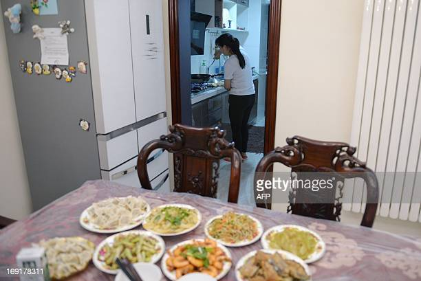 This picture taken on May 12 2013 shows a cook making dinner at Li Na's home in Beijing With two cars foreign holidays and a cook for their apartment...