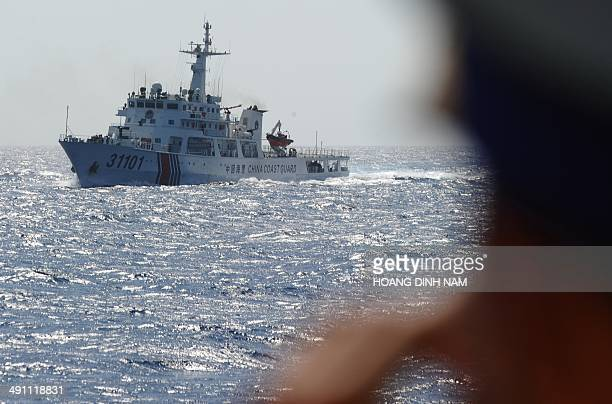 This picture taken on May 14 2014 from a Vietnamese coast guard ship shows a Chinese coast guard vessel sailling near the area of China's oil...