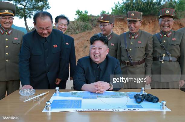 This picture taken on May 14 2017 and released from North Korea's official Korean Central News Agency on May 15 shows North Korean leader Kim JongUn...