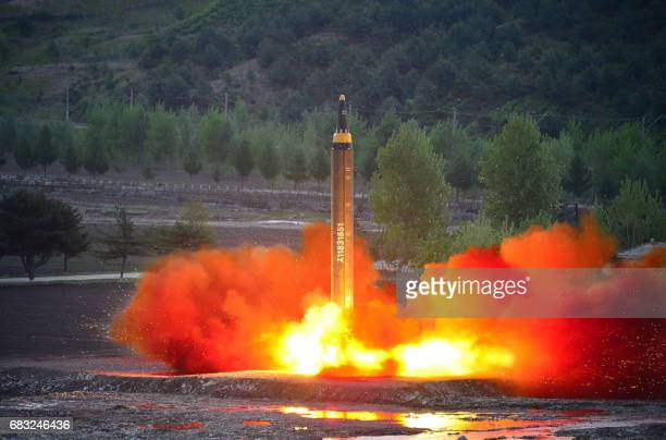 This picture taken on May 14 2017 and released from North Korea's official Korean Central News Agency on May 15 shows a test launch of the...