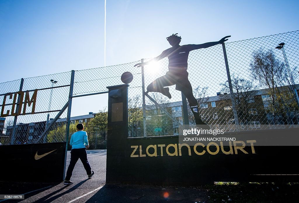 This picture taken on May 2, 2016 in the neighbourhood of Rosengard in Malmoe, where Swedish national team football player Zlatan Ibrahimovic grew up, shows his feet marked in a star with his signature next to Zlatan's court, where Zlatan played as a child. / AFP / JONATHAN