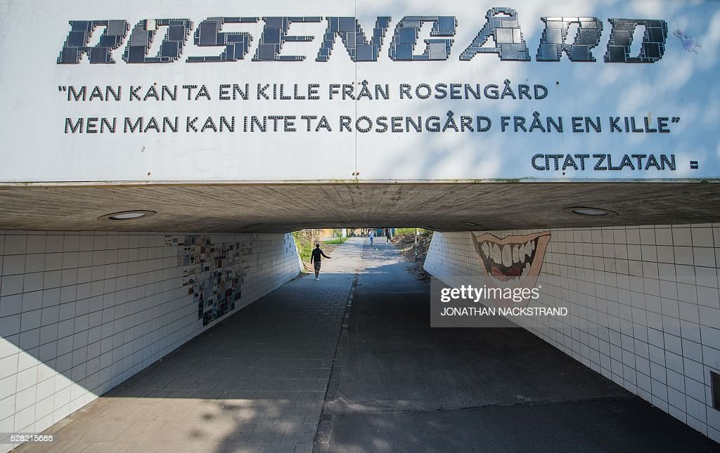This picture taken on May 2, 2016 in the neighbourhood of Rosengard in Malmoe, where Swedish national team football player, Zlatan Ibrahimovic grew up, shows a quote from Ibrahimovic 'You can take a men from Rosengard but you can't take Rosengard from a men'. / AFP / JONATHAN