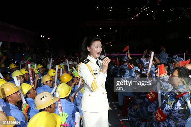 This picture taken on May 2 2016 shows Chinese folk singer Song Zuying performing for workers and military personnel on Fiery Cross Reef located in...