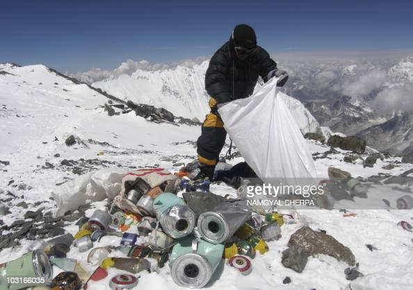 This picture taken on May 23 2010 shows a Nepalese sherpa collecting garbage left by climbers at an altitude of 8000 metres during the Everest...