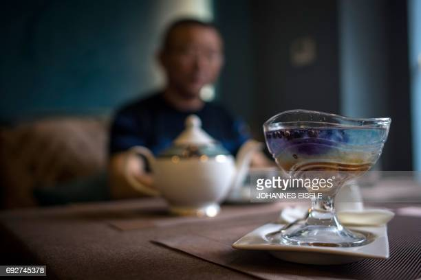 This picture taken on May 23 2017 shows a birds nest dessert in the NestCha restaurant in Shanghai The cries of amorous swiftlets echo around the...
