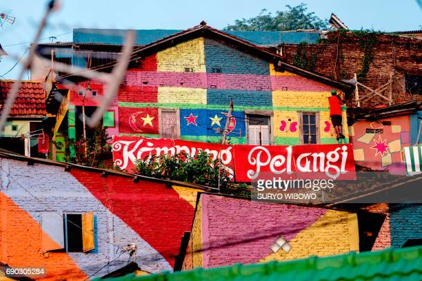 This picture taken on May 23 2017 shows an Indonesian hamlet dubbed 'the rainbow village' in Semarang central Java that has become an internet...