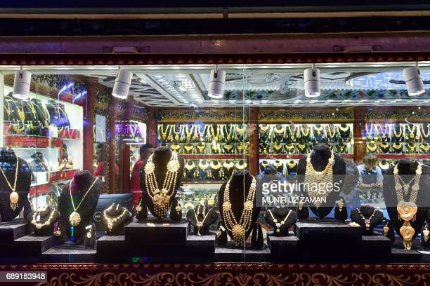 This picture taken on May 24 2017 shows gold jewelry displayed for sale at a shop in Dhaka Gold smuggling in Bangladesh is at a record high officials...