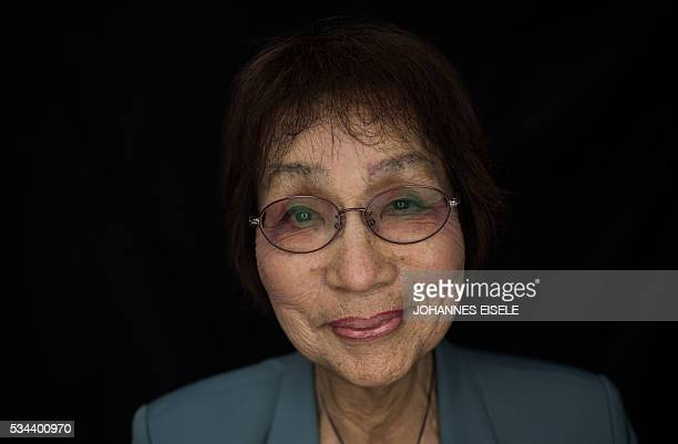 This picture taken on May 25 2016 shows Emiko Okada a survivor of the atomic bombing of Hiroshima posing for a picture at the Hiroshima Peace...