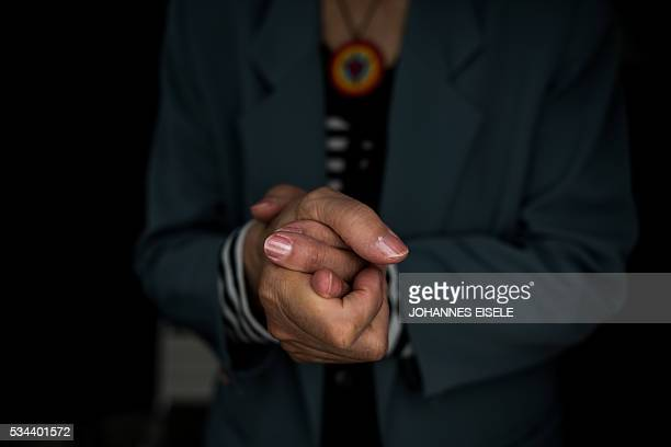 This picture taken on May 25 2016 shows the hands of Emiko Okada a survivor of the atomic bombing of Hiroshima as she poses for a picture at the...