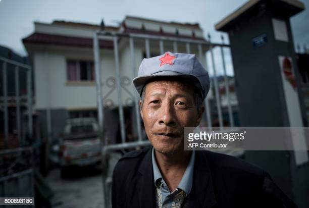 This picture taken on May 25 2017 shows Yang Renyi who is seeking compensation money for his old house posing for a portrait in front of his new...
