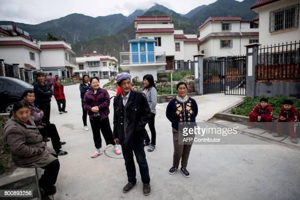 This picture taken on May 25 2017 shows Yang Renyi who is seeking compensation money for his old house standing with other villagers in front of his...