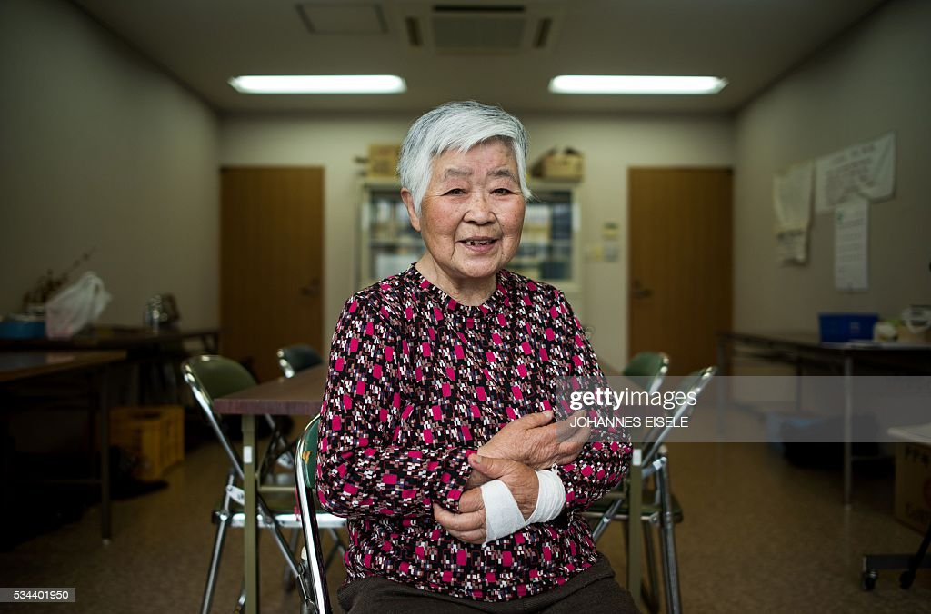 This picture taken on May 26, 2016 shows Misako Katani, 86, who was exposed to radiation in Hiroshima and Nagasaki, posing for a picture at a nursery home in Hiroshima Prefecture. Katani, who survived the Hiroshima blast August 6, 1945, was then again exposed to radiation in Nagasaki shortly after that city was bombed on August 9. US President Barack Obama is set to become the first sitting US president to visit one of the bomb sites when he journeys on May 27, 2016 with Japanese Prime Minister Shinzo Abe to Hiroshima, hallowed ground to Japanese but, for more than 70 years, a no-go zone for 11 of his Oval Office predecessors. / AFP / JOHANNES