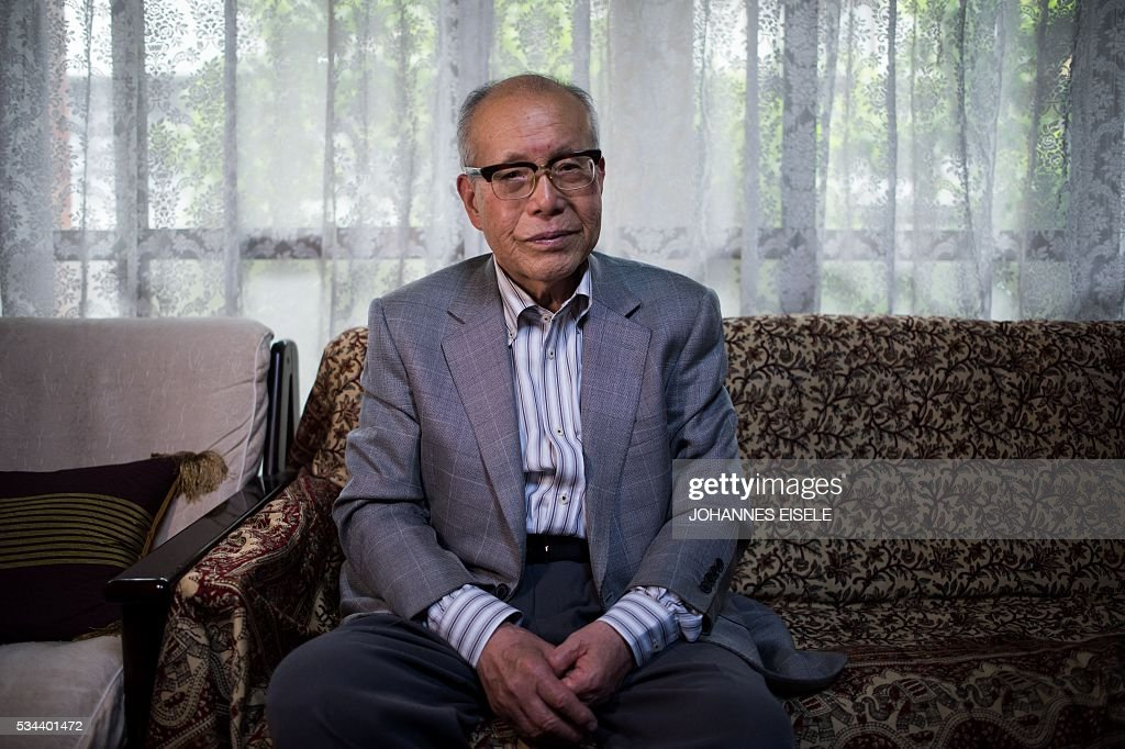 This picture taken on May 26, 2016 shows Shigeaki Mori, a survivor of the atomic bombing of Hiroshima and a historian, posing for a picture at his home in Hiroshima. The atomic blast at Hiroshima on August 6, 1945 killed 140,000 people, half of whom died quickly from intense heat, a huge shock wave, and radiation. US President Barack Obama is set to become the first sitting US president to visit one of the bomb sites when he journeys on May 27, 2016 with Japanese Prime Minister Shinzo Abe to Hiroshima, hallowed ground to Japanese but, for more than 70 years, a no-go zone for 11 of his Oval Office predecessors. / AFP / JOHANNES