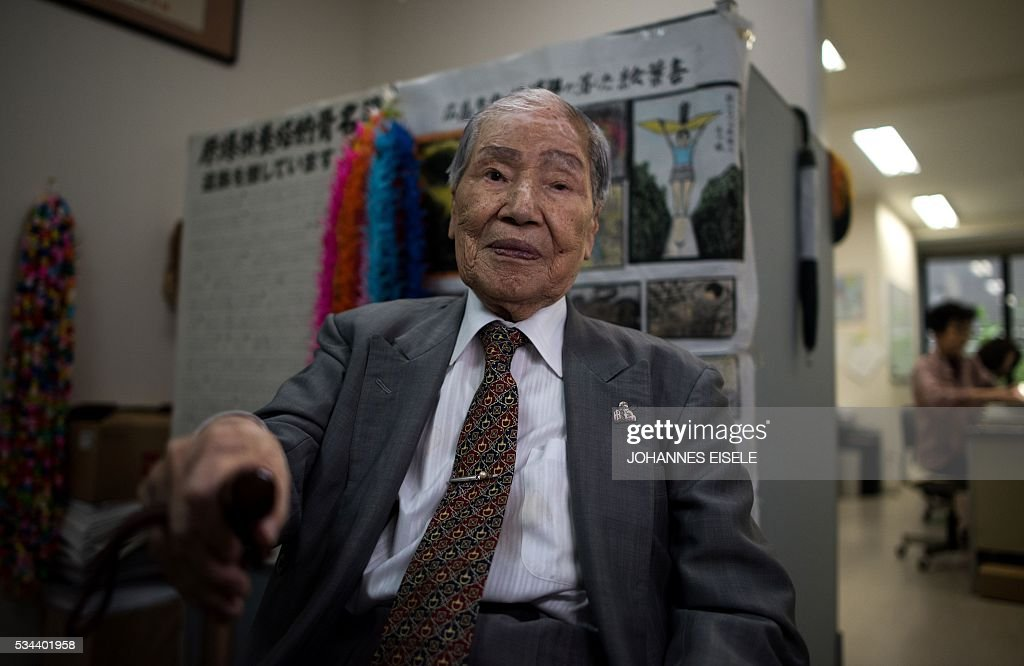 This picture taken on May 26, 2016 shows Sunao Tsuboi, a survivor of the atomic bombing of Hiroshima in 1945 and an anti-nuclear and anti-war activist, posing for a picture at an office in Hiroshima. Tsuboi was on his way to university when the bomb exploded over Hiroshima in a flash of blinding light and intense heat on August 6, 1945. US President Barack Obama is set to become the first sitting US president to visit one of the bomb sites when he journeys on May 27, 2016 with Japanese Prime Minister Shinzo Abe to Hiroshima, hallowed ground to Japanese but, for more than 70 years, a no-go zone for 11 of his Oval Office predecessors. / AFP / JOHANNES