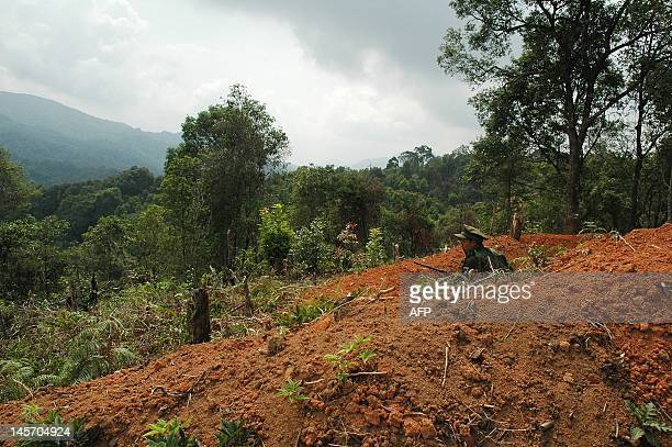 This picture taken on May 27 2012 shows a rebel soldier of the Kachin Independence Army looking out from a command post which protects the supply...