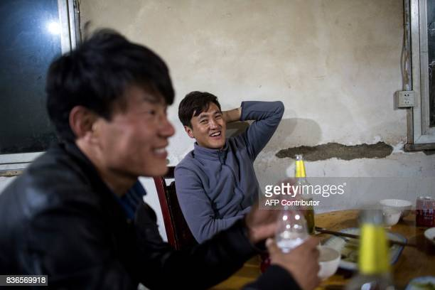 This picture taken on May 27 2017 shows Trinley Norbu and Tsultrim Paldzone sitting in a restaurant in Zhaba in the valley of the Yalong River in...