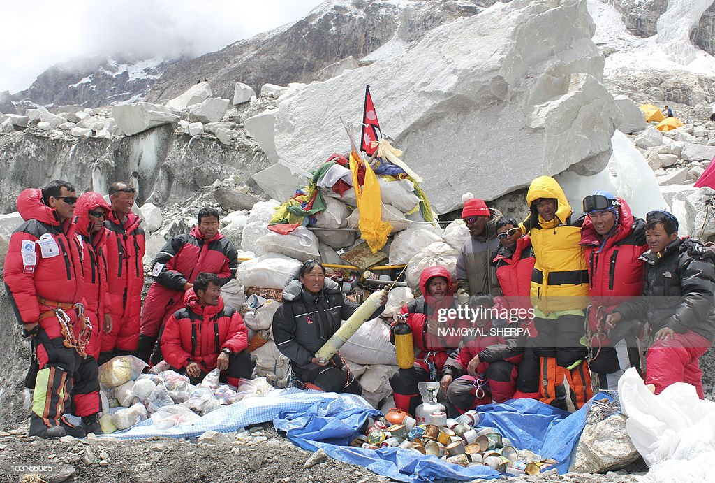 This picture taken on May 28, 2010 shows Nepalese sherpa climbers posing after collecting garbage from the Everest clean-up expedition at Everest Base Camp. A group of 20 Nepalese climbers, including some top summiteers collected 1,800 kilograms of garbage in a high-risk expedition to clean up the world's highest peak. Led by seven-time summiteer Namgyal Sherpa, the team braved thin air and below freezing temperatures to clear around two tonnes of rubbish left behind by mountaineers, that included empty oxygen cylinders and corpses. Since 1953, there have been some 300 deaths on Everest. Many bodies have been brought down, but those above 8,000 metres have generally been left to the elements -- their bodies preserved by the freezing temperatures. The priority of the sherpas had been to clear rubbish just below the summit area, but coordinator Karki said large quantities of refuse was collected from 8,000 meters and below. AFP PHOTO/Namgyal SHERPA