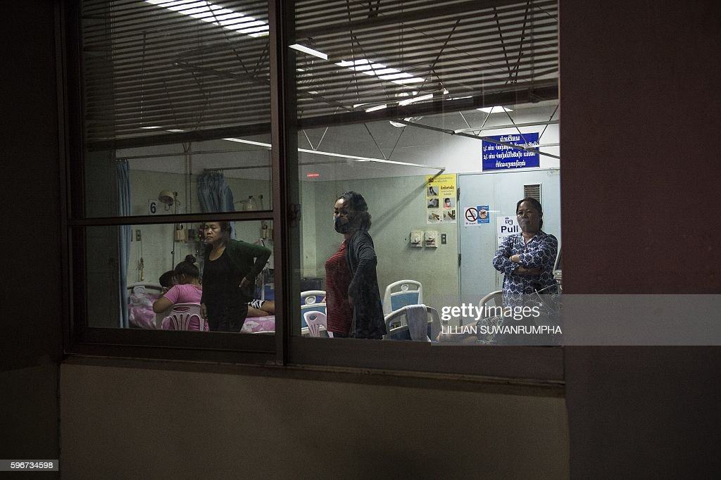 This picture taken on May 28 2016 shows people watching through a hospital window as Vientiane Rescue volunteers arrive in Vientiane Laos Founded in...